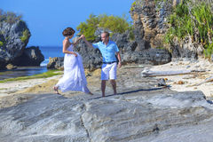 Loving Wedding Couple on Ocean Coastline. Stock Photos