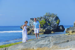 Loving Wedding Couple on Ocean Coastline. Stock Photography