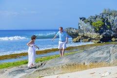 Loving Wedding Couple on Ocean Coastline. Stock Images