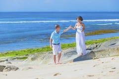 Loving Wedding Couple on Ocean Coastline. Royalty Free Stock Images
