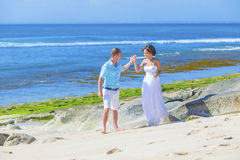 Loving Wedding Couple on Ocean Coastline. Stock Image