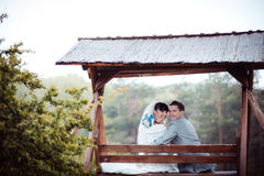 Loving wedding couple is sitting on a bench Stock Photo