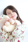 Loving White girl Pajamas hugging elephant toy Royalty Free Stock Photo