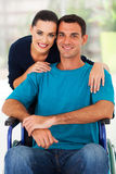 Wife handicapped husband. Loving wife and handicapped husband at home Royalty Free Stock Photography