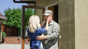 Loving wife meeting soldier at home royalty free stock photography