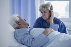 Wife supporting husband in hospital Stock Images