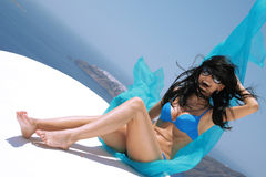 Beautiful woman on a roof in Santorini royalty free stock images