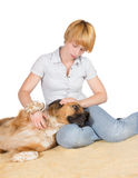 Loving woman with her dog Royalty Free Stock Photo