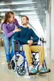 Loving Woman Supporting Handicapped Husband Royalty Free Stock Photography