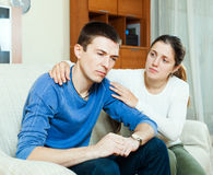 Loving woman tries reconcile with man Stock Photos