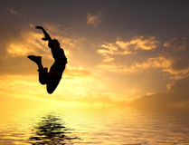 Loving the world. Woman jumping to water Royalty Free Stock Photos
