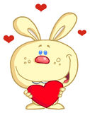 Loving Yellow Bunny. Holding A Red Heart Royalty Free Stock Images