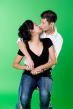 Loving young asian couple kissing each other Stock Image