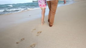 Loving young Caucasian couple holding hands walking together beach Oahu Hawaii. Romantic couple in love holding hands on walk on beautiful summer on hawaiian stock video