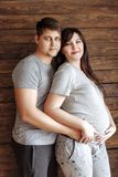 Young loving couple. Pregnant girl stock photography