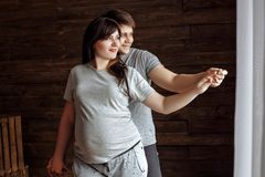 Young loving couple. Pregnant girl royalty free stock image
