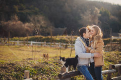 Loving young couple in autumn in the village. Royalty Free Stock Photo