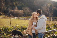 Loving young couple in autumn in the village. Stock Images