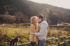 Loving young couple in autumn in the village. Stock Image