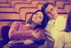 Loving young couple at date in cinema Stock Photos