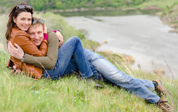 Loving young couple embracing on a hill top Stock Photo