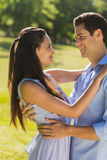 Loving young couple embracing at park Stock Photos