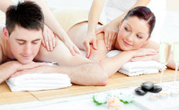 Loving young couple enjoying a back massage Stock Images