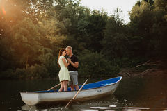 Loving young couple enjoying in the boat, blurred Royalty Free Stock Photography