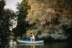 Loving young couple enjoying in the boat, blurred Royalty Free Stock Images