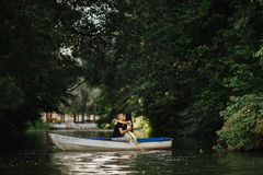 Loving young couple enjoying in the boat, blurred Stock Photos