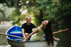 Loving young couple enjoying in the boat, blurred Royalty Free Stock Photos
