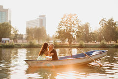 Loving young couple enjoying in the boat, blurred Stock Images
