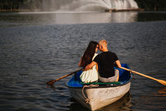 Loving young couple enjoying in the boat, fountain Stock Image