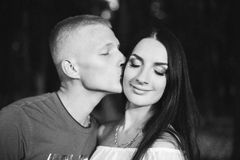 Loving young couple enjoying gentle kiss, blurred Royalty Free Stock Images
