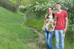 Loving young couple enjoying a walk in the hills Royalty Free Stock Image