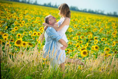 young couple in a field of sunflowers Stock Photos
