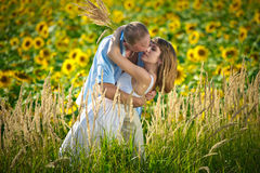Loving young couple in a field of sunflowers Royalty Free Stock Photos