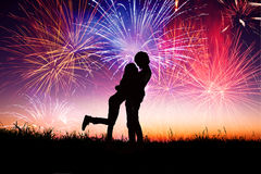 Loving young couple with fireworks Royalty Free Stock Image