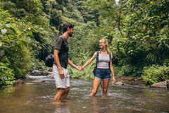 Loving young couple in forest stream Royalty Free Stock Images