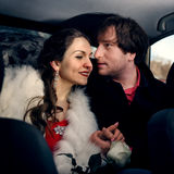Loving young couple. A young girl and a guy in the back seat of a car Royalty Free Stock Photo