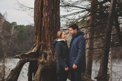 Loving young couple happy together outdoor on cozy warm walk in autumn forest Royalty Free Stock Photos