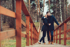 Loving young couple happy together outdoor on cozy warm walk in forest Royalty Free Stock Image
