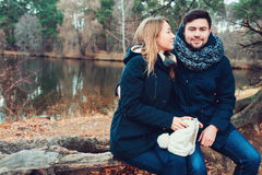Loving young couple happy together outdoor on cozy warm walk in forest Stock Photos