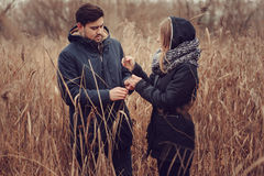 Loving young couple happy together outdoor on cozy warm walk in forest Stock Photo