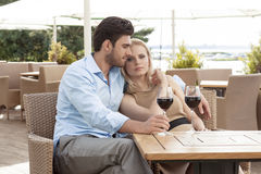 Loving young couple having red wine at outdoor restaurant Stock Image