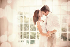Loving young couple holding hands at home Royalty Free Stock Image