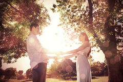 Loving young couple holding hands at park Royalty Free Stock Photos
