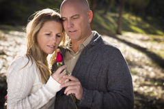 Loving Young Couple Holding a Rose Royalty Free Stock Photo