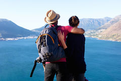 Loving young couple on holiday looking at beautiful view Stock Image