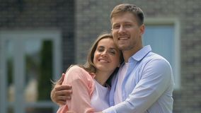 Loving young couple hugging smiling on camera, tender relations, young family